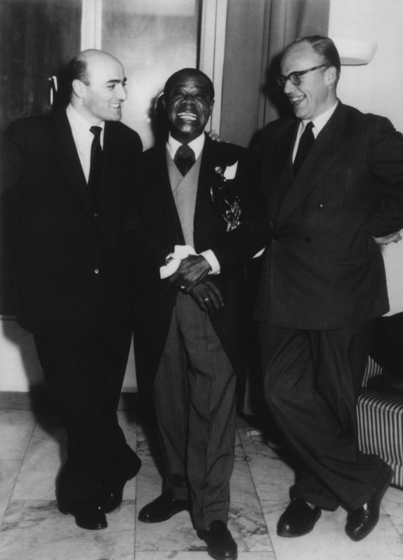 L-R: George Avakian, Louis Armstrong and Piet Beishuizen (PR director of Philips Germany) in 1955