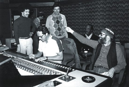 The mixing session for Anthony Davis' Of Blues and Dreams, fall 1978, in Toronto.  L to R: Anthony Davis, technician in background unknown), Phil Sheridan (recording engineer), John Norris, Buddy Tate, Bill Smith (producer) image 0