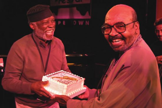 Ahmad Jamal gives James Moody a birthday cake at the 2002 North Sea Jazz Festival-Cape Town image 0