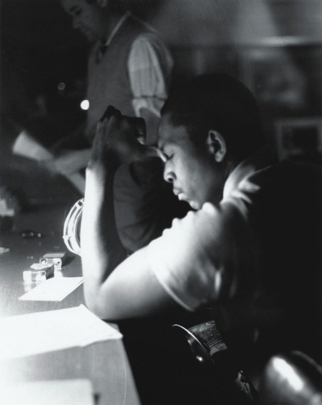 John Coltrane and Bob Thiele take a break from recording in Rudy Van Gelder's studio in the early 1960s