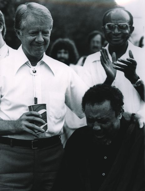 Jimmy Carter comforts a weeping Charles Mingus (photo: Karl Esch)