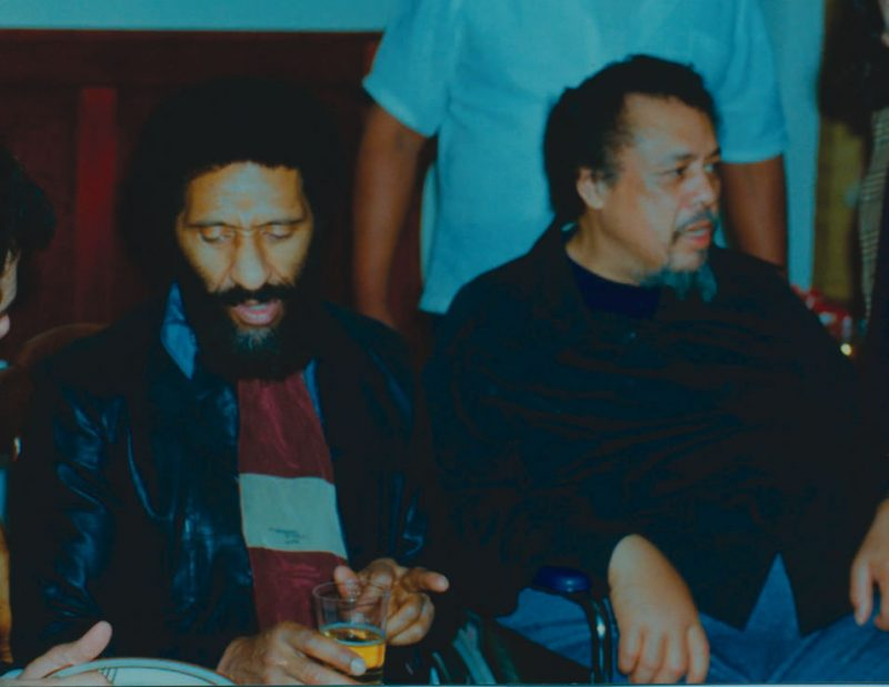 Charles Mingus at home with Sonny Rollins