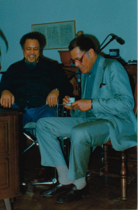 Charles Mingus at home with Dexter Gordon
