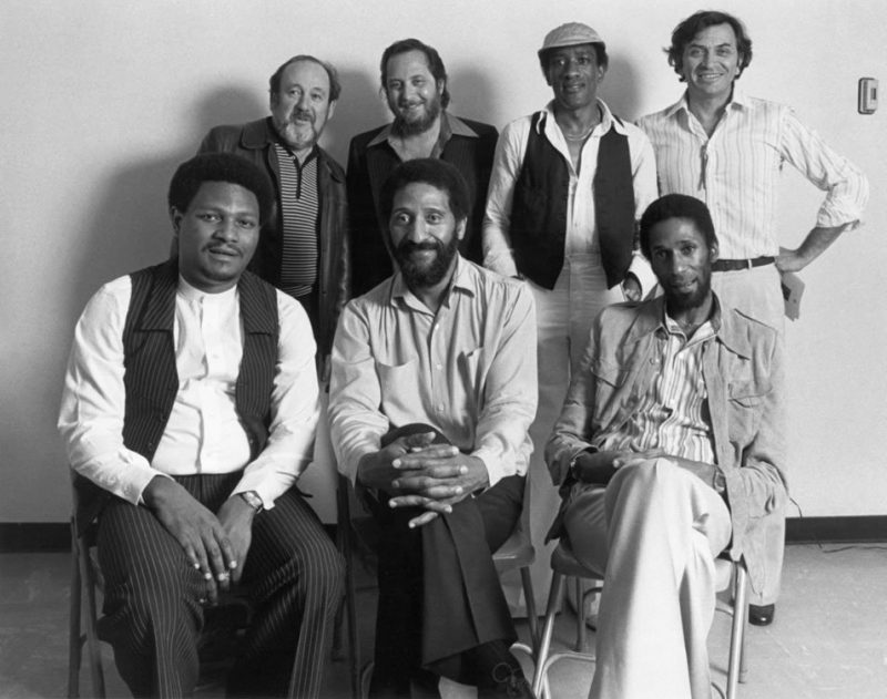 Backstage during the Milestone Jazzstars tour in San Francisco, 1978. Front row, L to R: McCoy Tyner, Sonny Rollins, Ron Carter. Back row, L to R: Producer Orrin Keepnews, record exec Ralph Kaffel, Al Foster, promoter Bill Graham.