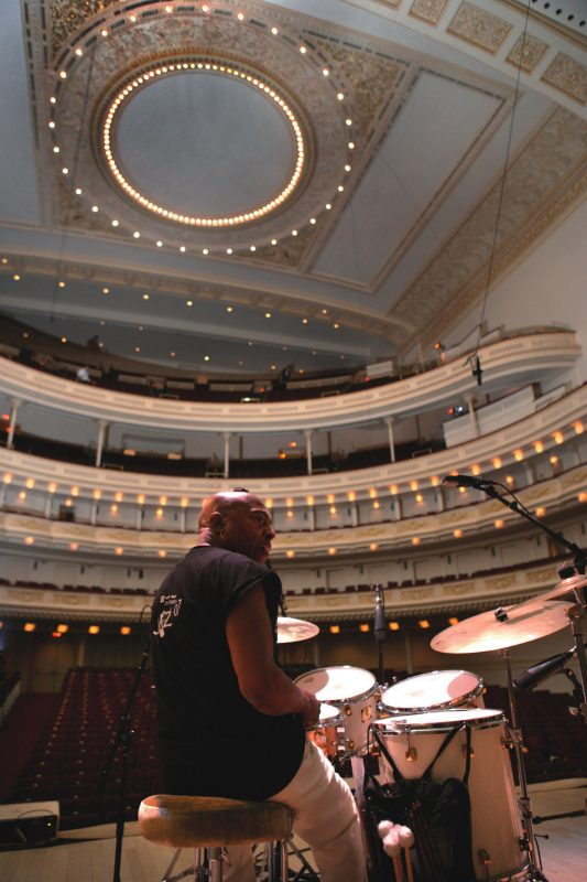 Since Carnegie Hall's management wouldn't allow me onstage, I handed my camera to Roy's son, Craig. I asked him to shoot a vertical from below, showing the ceiling above. Sometimes you have to be an art director.
