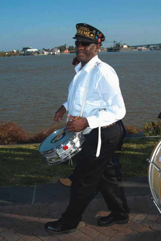 Scenes from second-line season, 2003-2006: Treme Brass Band snare-drummer extraordinaire Benny Jones, Sr.