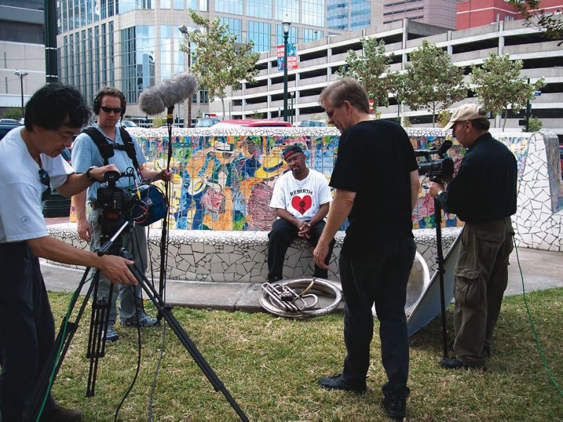 Robert Mugge and film crew preparing to interview Phil Frazier, leader of ReBirth Brass Band, in Houston.