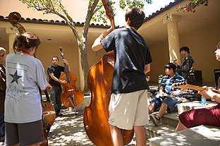 Jorge Roeder, teaching a class full of bass students at the Stanford Jazz Workshop