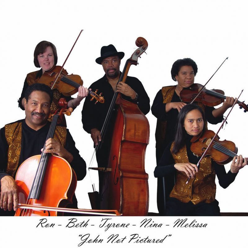 Tyrone Brown, center, with his string ensemble