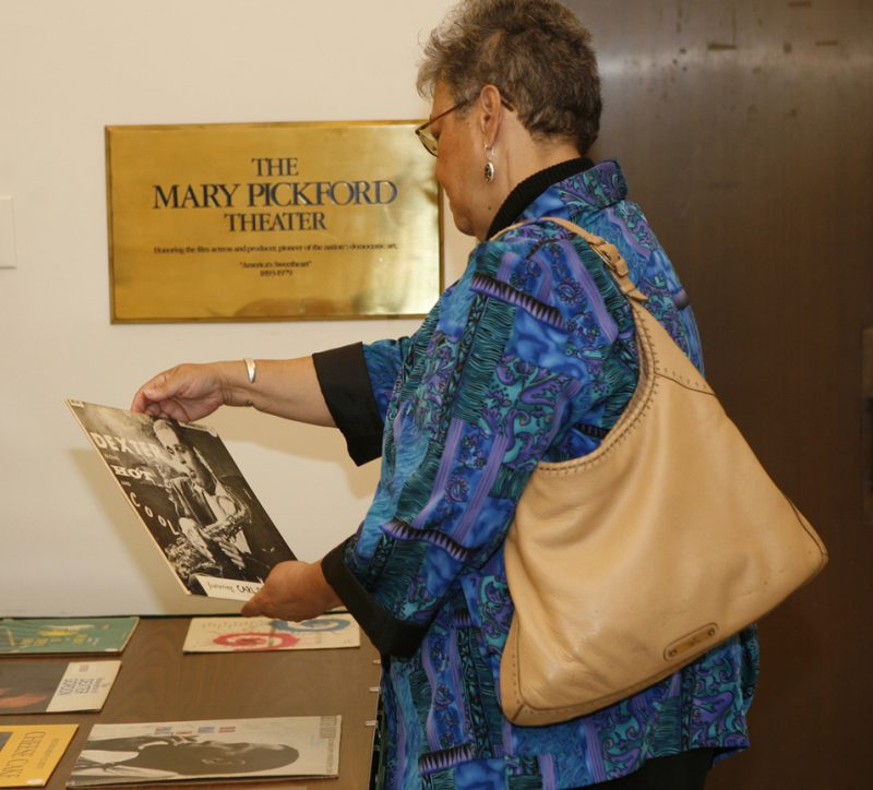 Visitor to the Library of Congress viewing some of the items contained in the newly acquired Dexter Gordon Collection