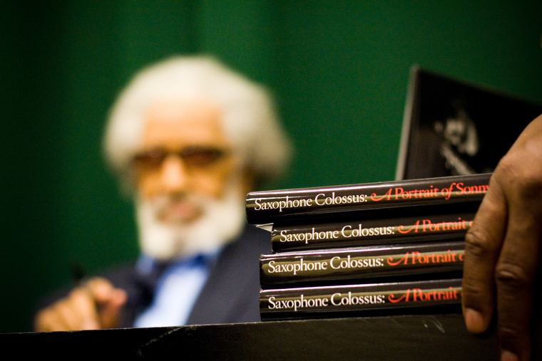 Sonny Rollins (background) at Saxophone Colossus book signing in NYC