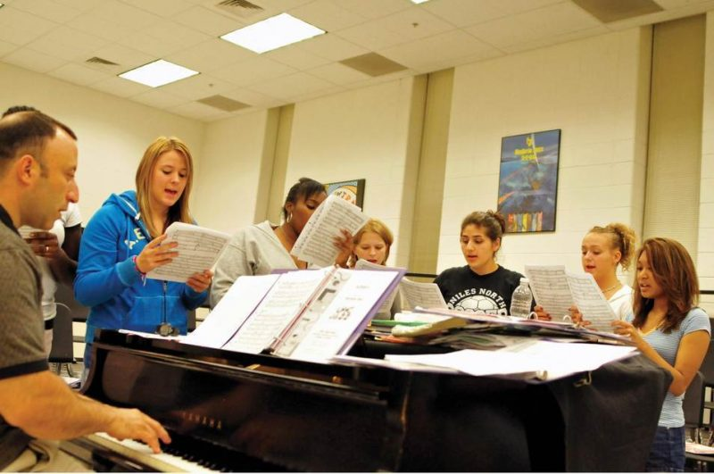 Students in Take One, vocal group at Niles North High School in Skokie, Ill rehearse with director Daniel Gregerman