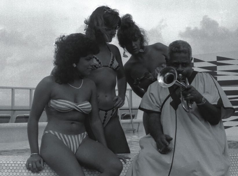 Dizzy Gillespie and admirers hang out on an early jazz cruise (photo: Ken Franckling)
