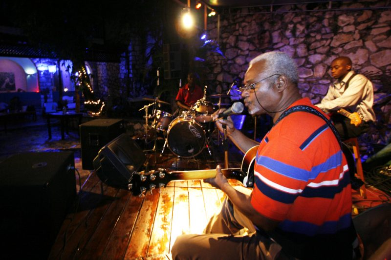 The Claude Carre Trio performs for a small audience at Cafe des Artes in Port-au-Prince in August 2010