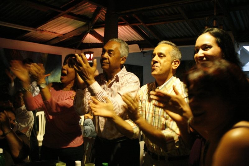 Audience members at the fine arts MWVA club in Jarbacoa, Dominican Republic, applaud Thomas during a performance in June 2010