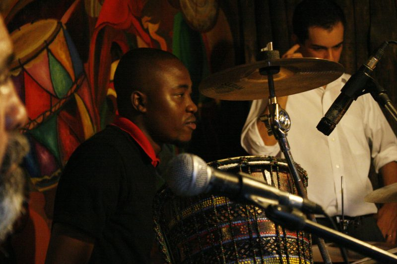 Haitian drummer Johnbern Thomas mixes Haitian percussion rhythms with the Latin jazz that his Dominican band members play