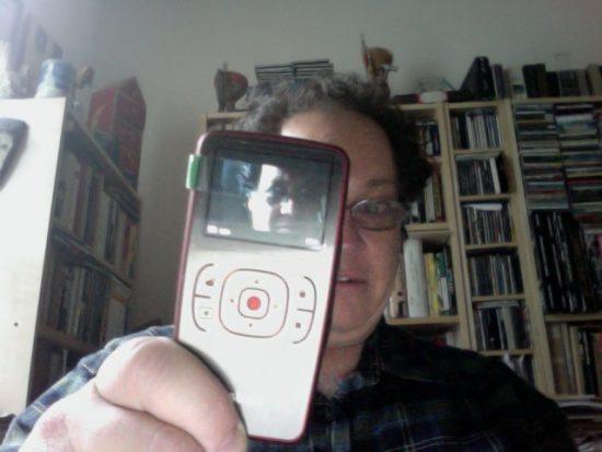 Howard Mandel demonstrating the flip camera technology image 0