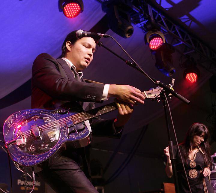 Guitarist Raven Kanataka with Digging Roots in performance at 2011 TD Toronto Jazz Festival