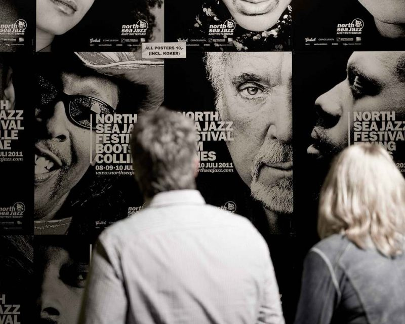 Visitors looking at some of the festival posters