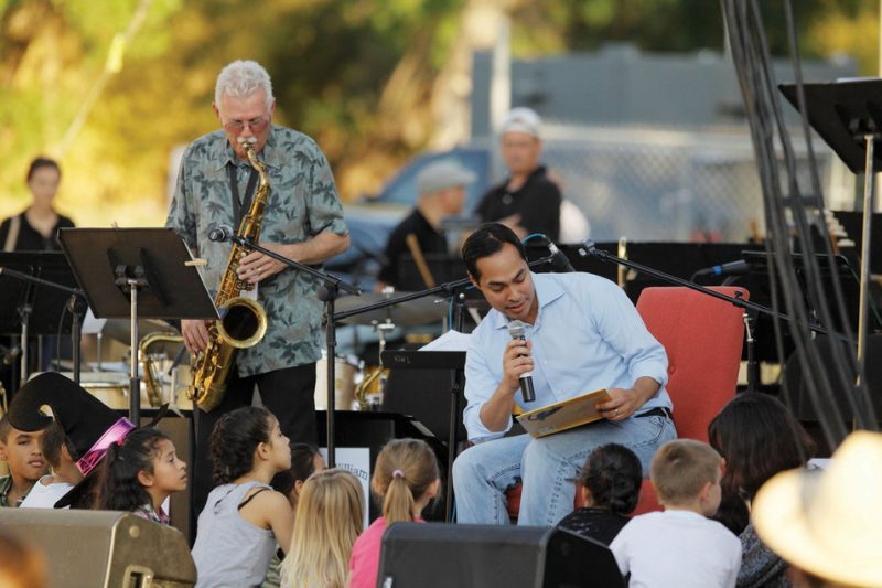 """Saxophonist Jim Waller and San Antonio Mayor Julián Castro during the reading of """"Charlie Parker Played Be Bop,"""" Oct. 23, 2011"""