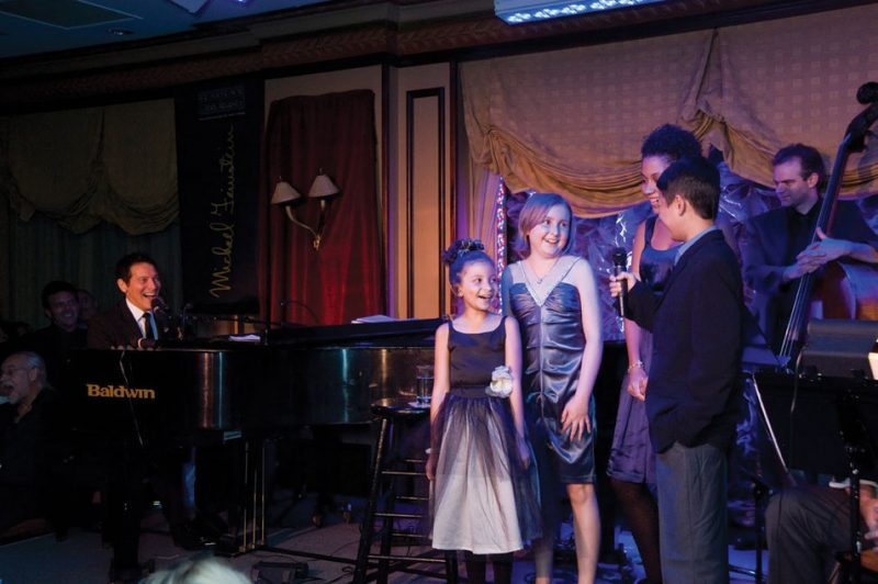 Michael Feinstein performing with Ronald McDonald House children in NYC
