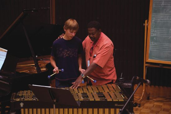 Stanford Jazz Workshop faculty member Ndugu Chancler with student image 0