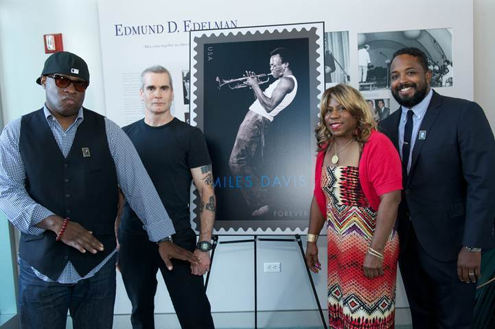 Vince Wilburn, Jr. (nephew of Miles Davis); Henry Rollins; Cheryl Davis (daughter of Miles Davis) and Erin Davis (son of Miles Davis) admire the new Miles Davis commemorative Forever Stamp, Los Angeles, 2012