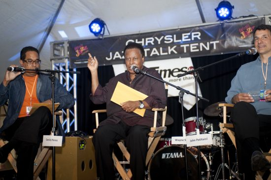 Renee Rosnes interviews members of the Wayne Shorter Quartet (Danilo Pérez, Wayne Shorter, John Patitucci and Brian Blade) in session at Talk Tent at 2012 Detroit Jazz Festival image 0