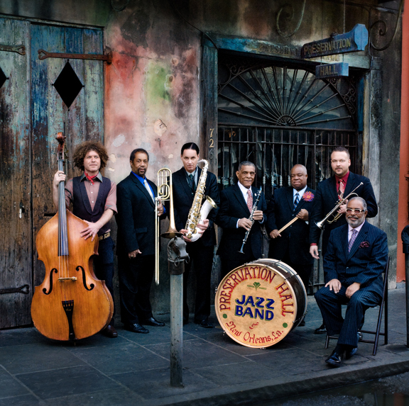 Preservation Hall Jazz Band, 2012. (L to R) Ben Jaffe(bass), Freddie Lonzo(trombone), Clint Maedgen(sax), Charlie Gabriel(clarinet), Joe Lastie (drums), Mark Braud (trumpet), and Rickie Monie(piano). Photo by Shannon Brinkman