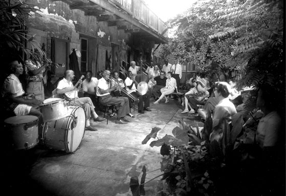 Preservation Hall Jazz Band: A courtyard jam in Preservation Hall's courtyard, circa 1961. Photo by Dan Leyrer