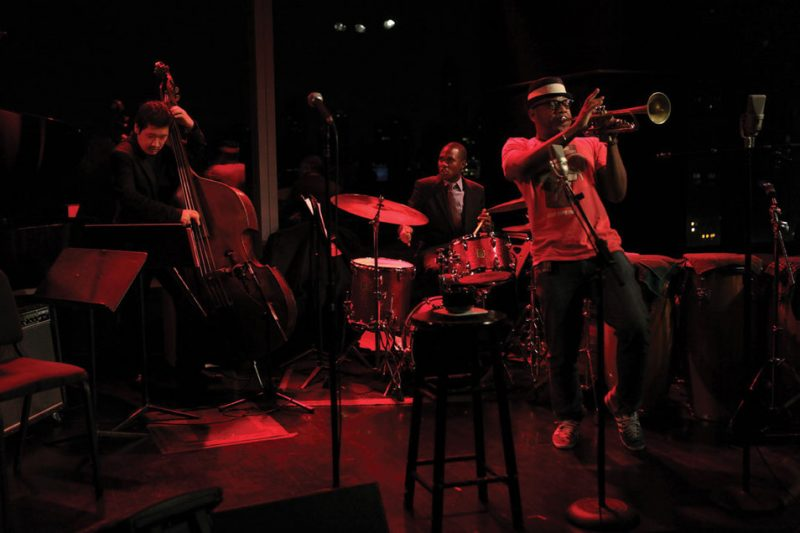 An invitation-only jam session at Dizzy's Club Coca-Cola in NYC, featuring trumpeter Etienne Charles, bassist Yasushi Nakamura and drummer Brian Carter