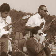 Paul Butterfield Blues Band members Mike Bloomfield, Butterfield (bottom) and Jerome Arnold at the Newport Folk Festival, 1965 image 0