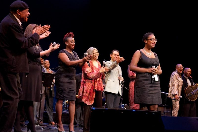 Al Jarreau, Jane Monheit, Terence Blanchard, Ledisi, Kurt Elling, Dee Dee Bridgewater, and Kevin Eubanks congratulate First Place winner Cecile McLorin Salvant (center).