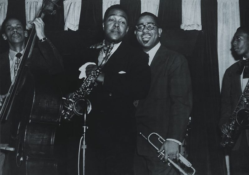 "From Ken Burns' Jazz: Charlie ""Bird"" Parker and Dizzy Gillespie on stage at Birdland with a young John Coltrane (with sax) and Tommy Potter on Bass from Episode 7 (""Dedicated to Chaos,"" 1940-1945)"