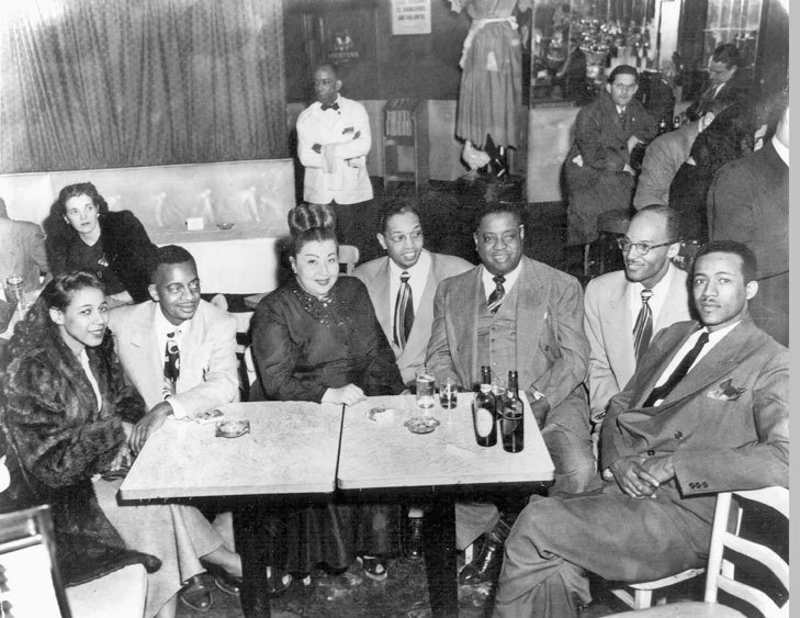 Dr. Billy Taylor (center) with Art Tatum (third from right) and friends at a club in New York City