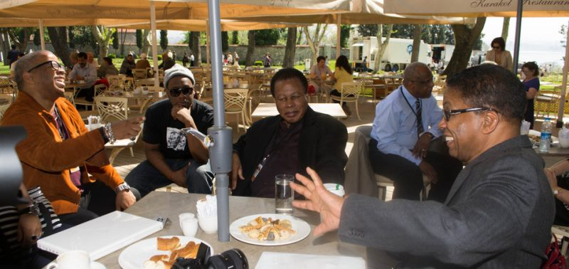 l. to. r., Terence Blanchard, Robert Glasper, Wayne Shorter and Herbie Hancock chat prior to a press conference for International Jazz Day, April 2013