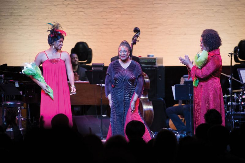 Lizz Wright (left), and Dianne Reeves (right) join the Apollo Theater audience in applauding Geri Allen at her celebration of jazz's great female artists, May 2013