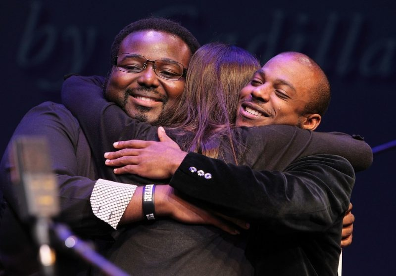 The finalists embrace at the 2013 Thelonious Monk International Jazz Saxophone Competition: Godwin Louis (third place), Melissa Aldana (first) and Tivon Pennicott (second), from left