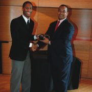 "JLCO reedist Victor Goines presents New Orleanian pianist Jonathan Batiste with the Movado ""Future Legends of Jazz"" Award, at an honary luncheon held Nov. 7 at Dizzy's Club Colca-Cola. image 0"