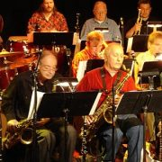 Sam Falzone (in red) with members of the Don Ellis Orchestra at 2005 reunion image 0