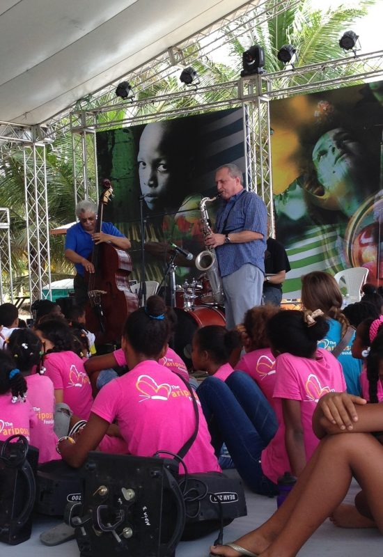 Bassist Rufus Reid and saxophonist George Garzone giving a workshop, Dominican Republic Jazz Festival 2013. Drummer Billy Drummond is obscured.