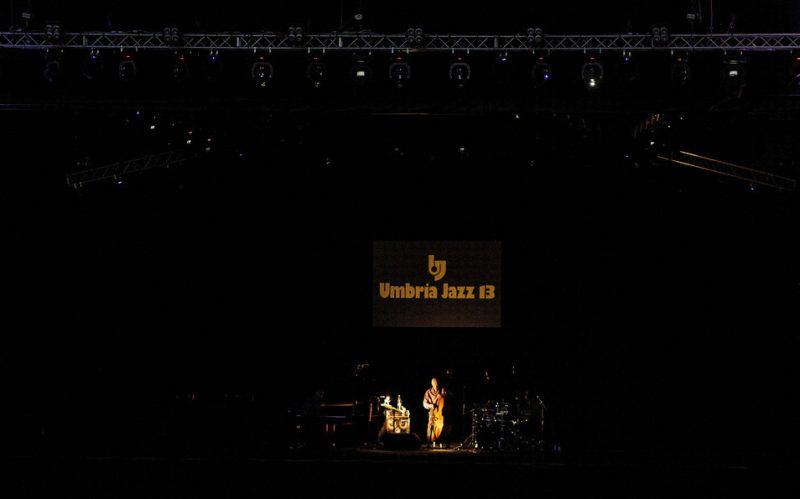 The Keith Jarrett Trio performs in near total darkness at the Umbria Jazz Festival, July 2013