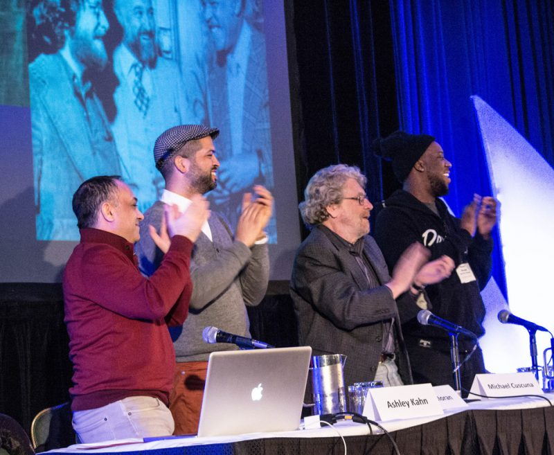 "Ashley Kahn, Jason Moran, Michael Cuscuna and Robert Glasper (l. to r.) applaud the arrival of Bruce Lundvall, former president of Blue Note Records, at the ""Blue Note at 75"" tribute, Jazz Connect, NYC, Jan. 2014"