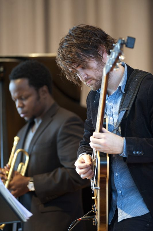 Guitarist Justin Altura in performance with Ambrose Akinmusire at the Albright-Knox Art Gallery in Buffalo on Sunday, March 23