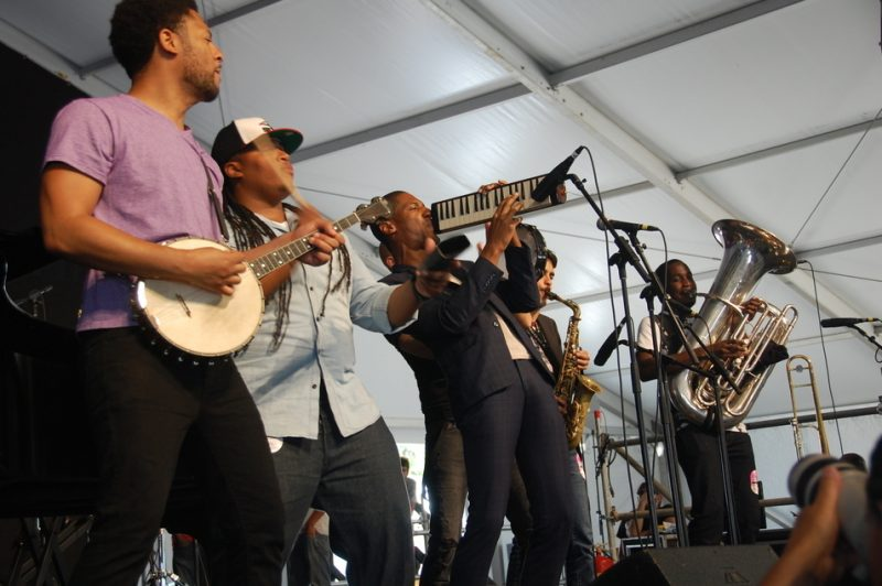 Jon Batiste (on melodica) and Stay Human at the 2014 New Orleans Jazz & Heritage Festival