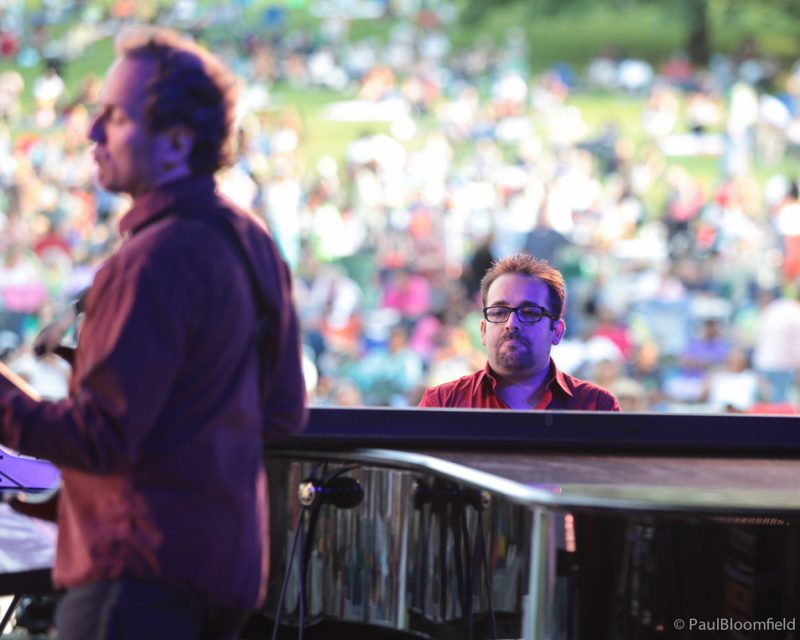 Manuel Valera on piano with Hans Glawischnig on bass in foreground at the Greater Hartford Festival of Jazz 2014