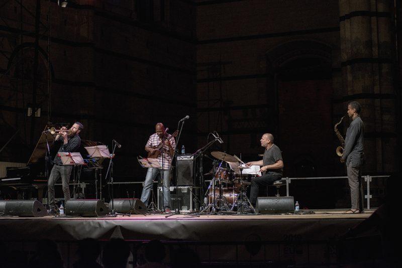 Avishai Cohen, Lionel Loueke, Jeff Ballard, Mark Turner. Piazza del Duomo, Siena Jazz Workshops, 2014