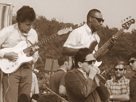 Paul Butterfield Blues Band members Mike Bloomfield, Butterfield (bottom) and Jerome Arnold at the Newport Folk Festival, 1965