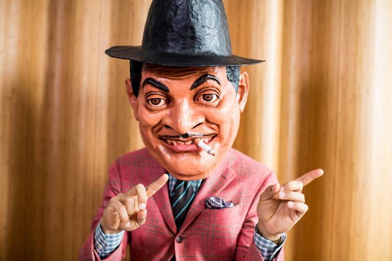 """Jason Moran as Fats Waller; the mask is a prop in Moran's """"Fats Waller Dance Party"""" shows"""