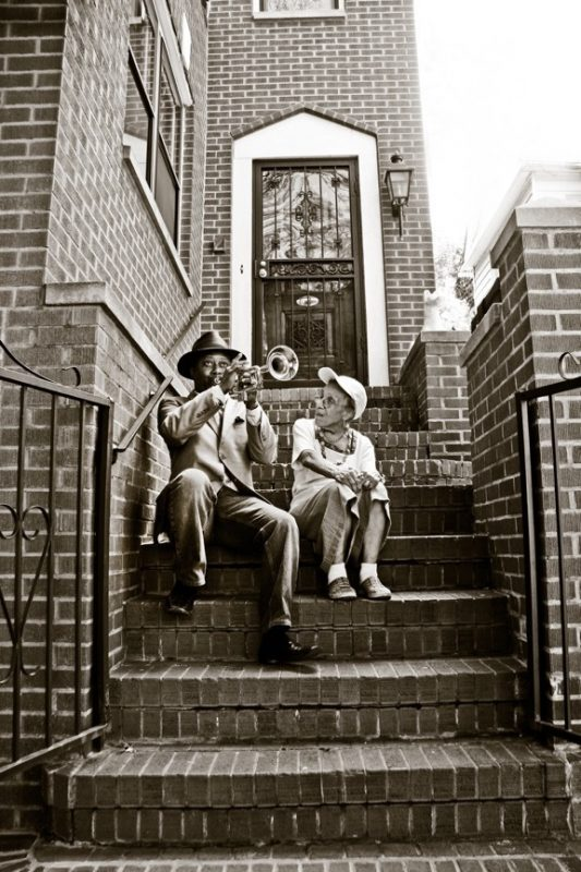 Kermit Ruffins and Selma (Louis Armstrong's neighbor) on the steps of Louis' house